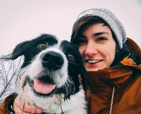Dog and girl smiling in winter